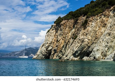 View on cliffs, blue sky with clouds and sail