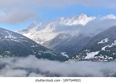 view on clouds and peak mountain covered with snow