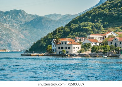 View on the coast from ferry transporting cars and people in Lepetane, Tivat, Montenegro.