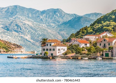 View on the coast from ferry transporting cars and people in Lepetane, Kotor, Montenegro.
