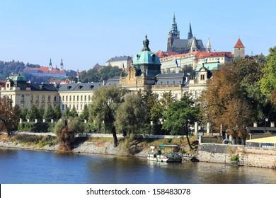 View on the colorful autumn Prague gothic Castle above River Vltava, Czech Republic