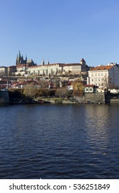 View on the colorful autumn Prague gothic Castle above River Vltava, Czech Republic