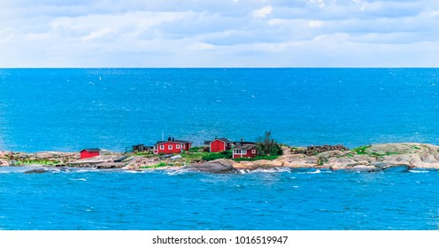 View on colorful building on rocky island by Helsinki - Finnland