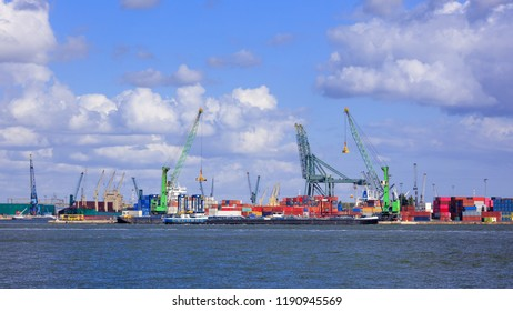 View on container terminal with massive cranes and stacked containers, Port of Antwerp, Belgium