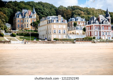 View on the cooastline with sandy beach and luxury buildings in Trouville, famous french town in Normandy
