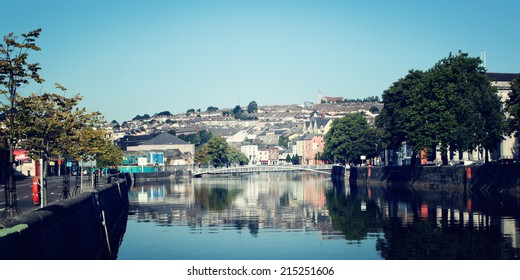 View on the Cork city - vintage effect. Early morning in Ireland - photo with retro filter. Quiet sunrise in the River Lee, Munster, Ireland.