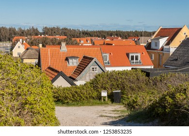 View on cottages  with red tile roofs in Lokken village - Denmark.