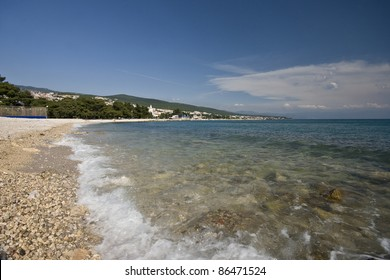 View on the Crikvenica pebble beach in the summer