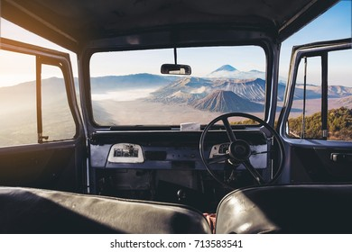 View on the dashboard of the car. Bromo mountains is in front of the car.