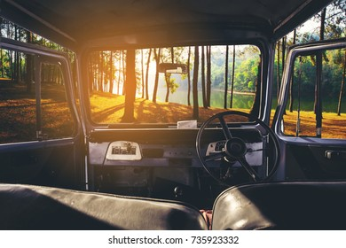 View on the dashboard of the car. Sunset view is in front of the car at Pang Ung in Mae Hong Son ,Thailand.