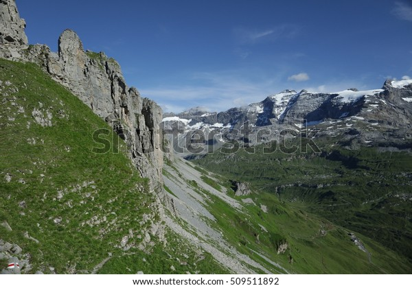 View on different mountains in Switzerland from a hiking path.