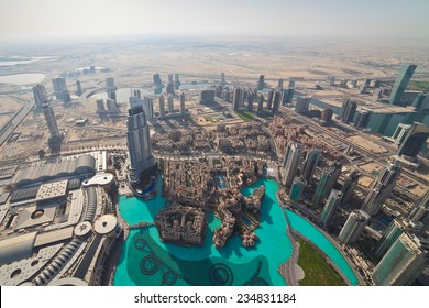 View on Downtown Dubai from Burj Khalifa at sunny morning, United Arab Emirates.