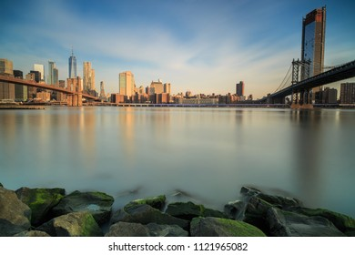 View on downtown manhattan with Brooklyn and manhattan bridge from the rocks during sunrise