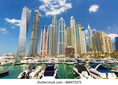 View on Dubai Marina bay with promenade and luxury skyscrapers around in Dubai