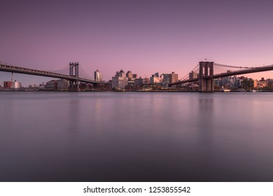View on Dumbo location with Manhattan Bridge and Brooklyn Bridge from east river at sunset