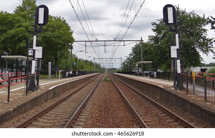 A view on the dutch railway Heerlen - Sittard at the station of Hoensbroek with two train signals