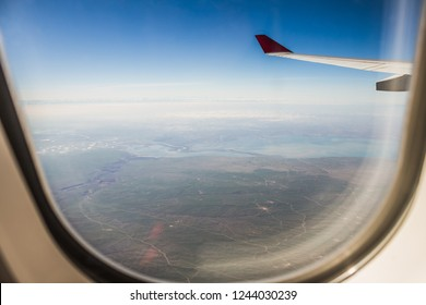 view on earth from the window of the airplane.