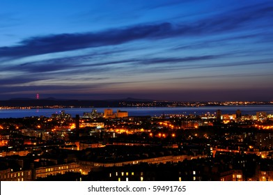 View on Edinburgh city and harbor in night from Nationl Monument, Scotland