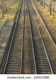 View on empty tram tracks from a bridge