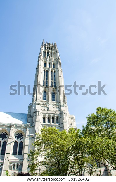 View on the facade of the catholic cathedral in the uptown of Manhattan during daytime in summer. The architecture of the christen church in the modern city. New York. United States of America