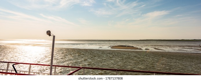 View on the fairway and sandbanks in the Wadden Sea from a ferryboat to the Dutch isle Schiermonnikoog.