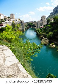 view on famous Mostar Bridge (Stari Most) and turquoise water of Neretva river in touristic and historic gem Mostar city, Bosnia and Herzegovina, Balkan peninsula, Southeastern Europe