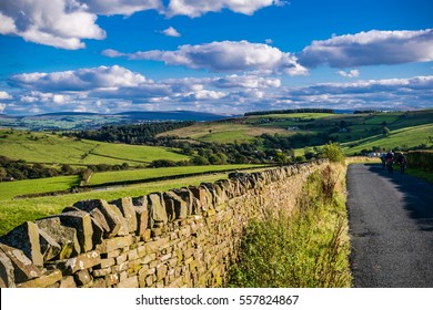 View on farms and countryside road, tarmac road, Summer, blue sky and white clouds, Forest Of Bowland, Lancashire, England, UK