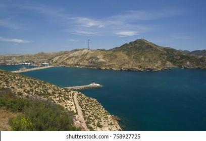 View on Faro de Navidad and entrance to port of Cartagena and Mediterranean sea (Cartagena, Murcia, Spain)