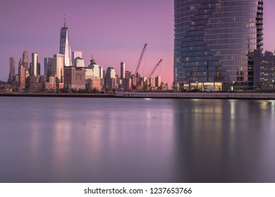 View on finance district Manhattan and Jersey city skyscrapers at sunset from Hudson river