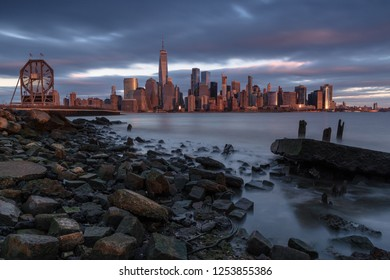 View on Financial District  and colgate watch from rocky beach in Jersey city at sunset