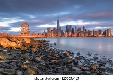 View on Financial District  and Colgate watch from rocky beach in Jersey city at sunset ,Long exposure shot