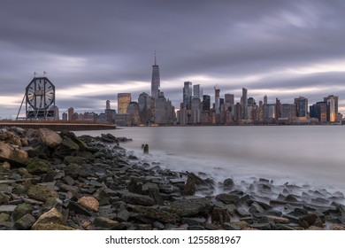 View on Financial District from rocky beach in Jersey city at sunset
