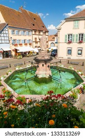 view on fountain in Eguisheim village, Alsace, France