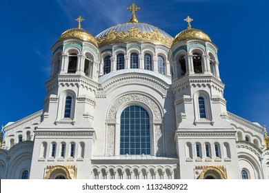 View on front facade of Naval Cathedral of St. Nicholas (Nikolsky Marine Cathedral) with deep blue sky in Kronshtadt, Saint-Petersburg, Russia