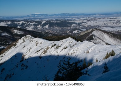 View on frozen Babia Gora from Tatra Mountains in winter during sunny day, Malopolskie Poland - Shutterstock ID 1878498868