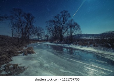 View on the frozen river Thaya at night lit by moonlight