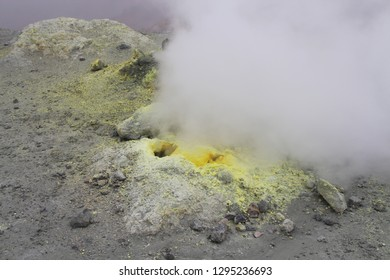 View on fumarole in crater of Mutnovsky volcano. It's an opening in a planet's crust, which emits steam and gases such as carbon dioxide, sulfur dioxide, hydrogen chloride, and hydrogen sulfide.