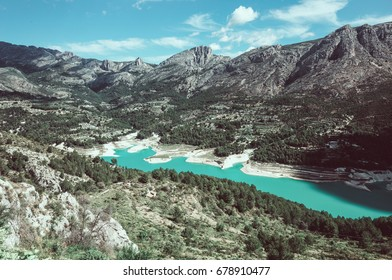 View on Guadalest water reservoir with turquoise water in Alicante province in Spain