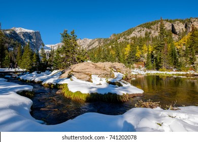 View on Hallett Peak and Flattop Mountain in snow at autumn. Trail to Emerald Lake. Rocky Mountain National Park in Colorado, USA.