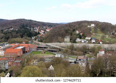 view on the hills and the buildings in bielefeld germany photographed during a sightseeing tour at a sunny day