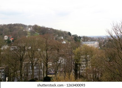 view on the hills and buildings from the roof top at the sparrenburg in bielefeld germany photographed during a sightseeing tour at a sunny day