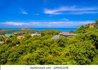 View on the hillside in the day time overlooking the beautiful villa and nice blue sky