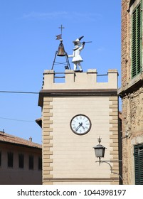 View on the historic Pulcinella Tower with clock in Montepulciano, Tuscany, Italy