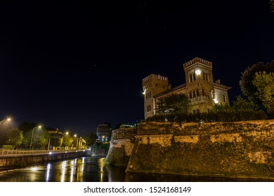 View on a historical bastion and Sile river in front of the walls with beautiful sky at night. Treviso Italy