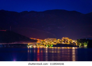 View on illuminated coastline at night in Budva, Montenegro