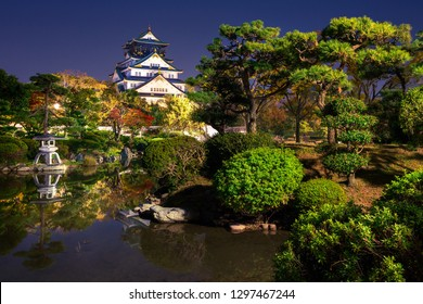 view on illuminated Osaka Castle from the garden at night, Osaka, Japan
