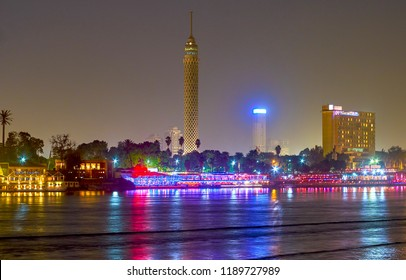 The view on illuminated restaurants located on the bank of Nile river in Cairo, Egypt