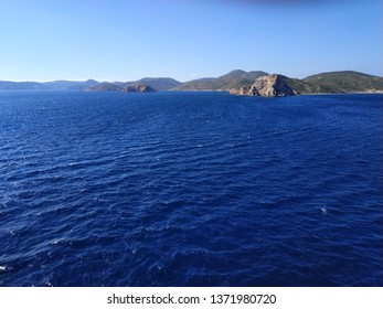 view on island in open Mediterranean sea in sunny weather
