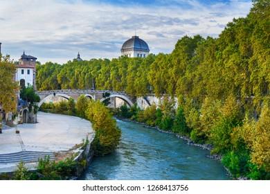 View on Isola Tiberina or Tiber Island and Ponte Fabricio bridge in Rome. Italy