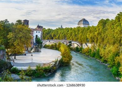 View on Isola Tiberina or Tiber Island and Ponte Garibaldi bridge in Rome. Italy